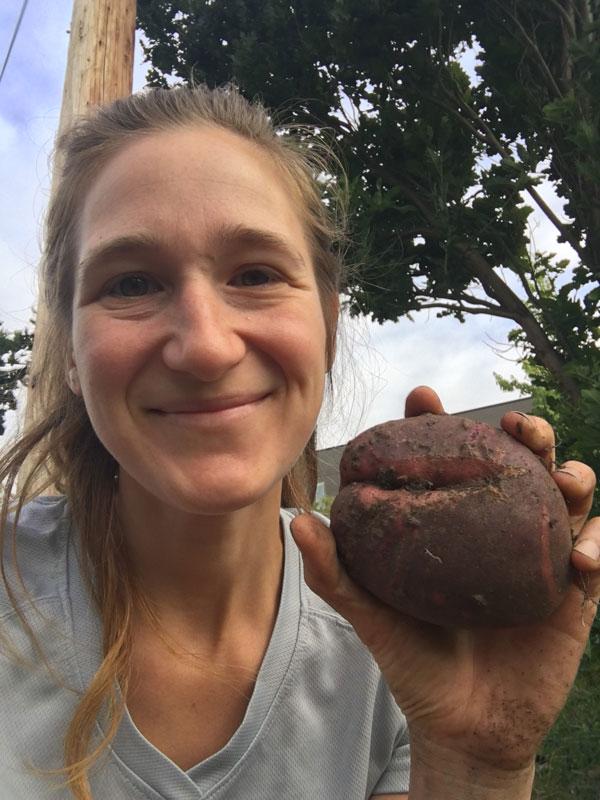 Kindra De'Arman with homegrown potato